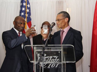 Minister Moses and H.E. John L. Estrada toast in celebration of Independence of the United States of America.