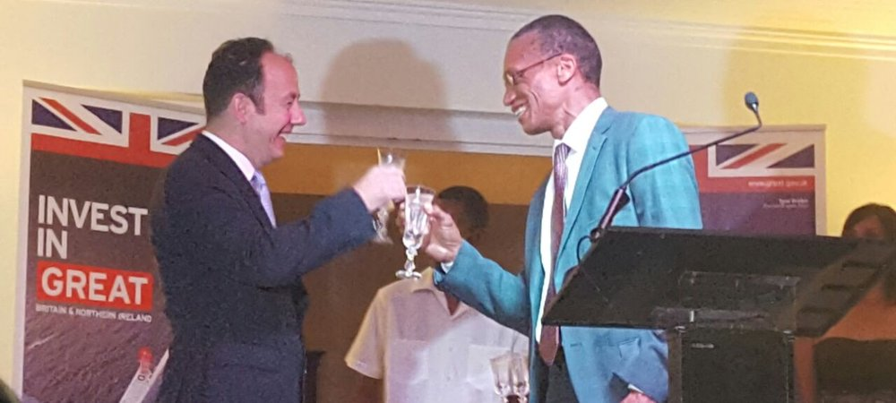 Sen. Hon. Dennis Moses, Minister of Foreign and CARICOM Affairs toast with H.E. Tim Stew, High Commissioner for the United Kingdom of Great Britain and Northern Ireland at a reception on the occasion of the birthday of Her Majesty Queen Elizabeth II