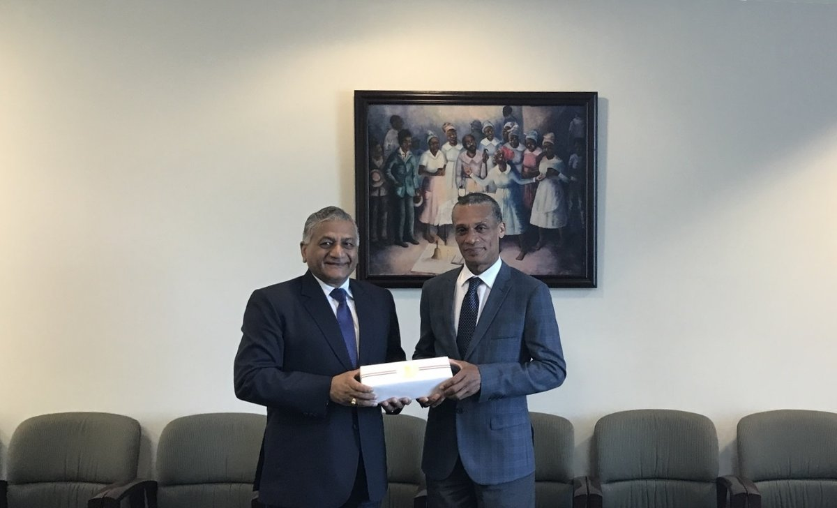 Senator the Honourable Dennis Moses, Minister of Foreign and CARICOM Affairs is presented with a gift by  General Vijay Kumar Singh (Ret'd) during a recent meeting