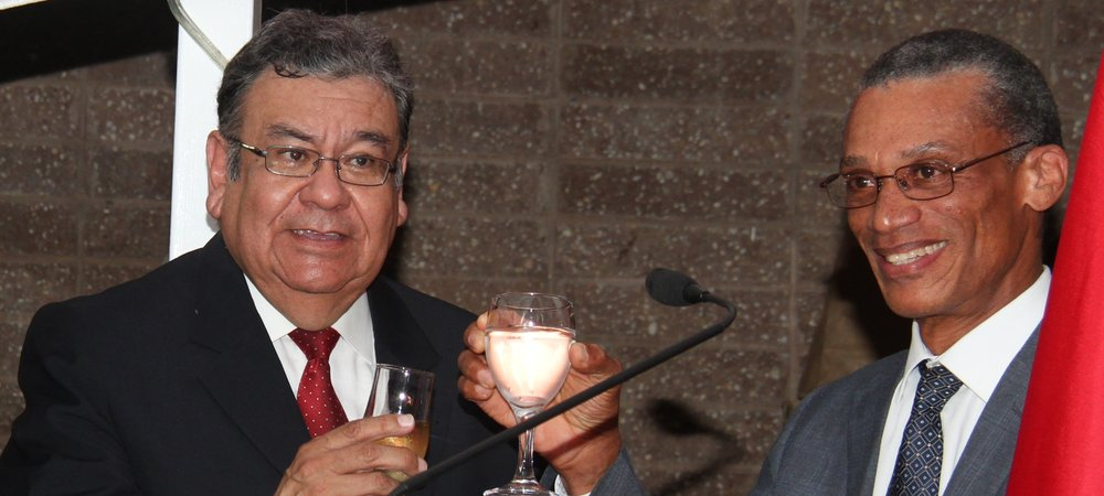 Hon. Dennis Moses, Minister of Foreign and CARICOM Affairs and H.E. Luis Rodomiro Hernández Ortiz, Ambassador of the Republic of Peru toast at the reception in commemoration of the 196th Anniversary of the Independence of the Republic Peru