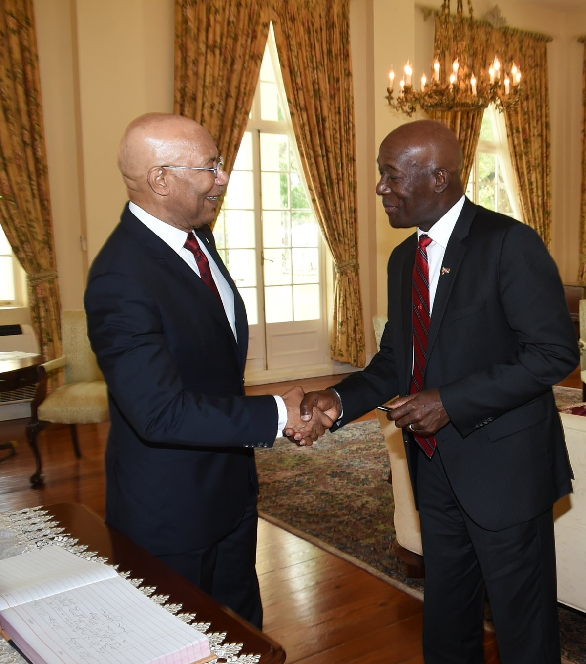 Prime Minister Dr. Keith Rowley is greeted by Jamaica's Governor General