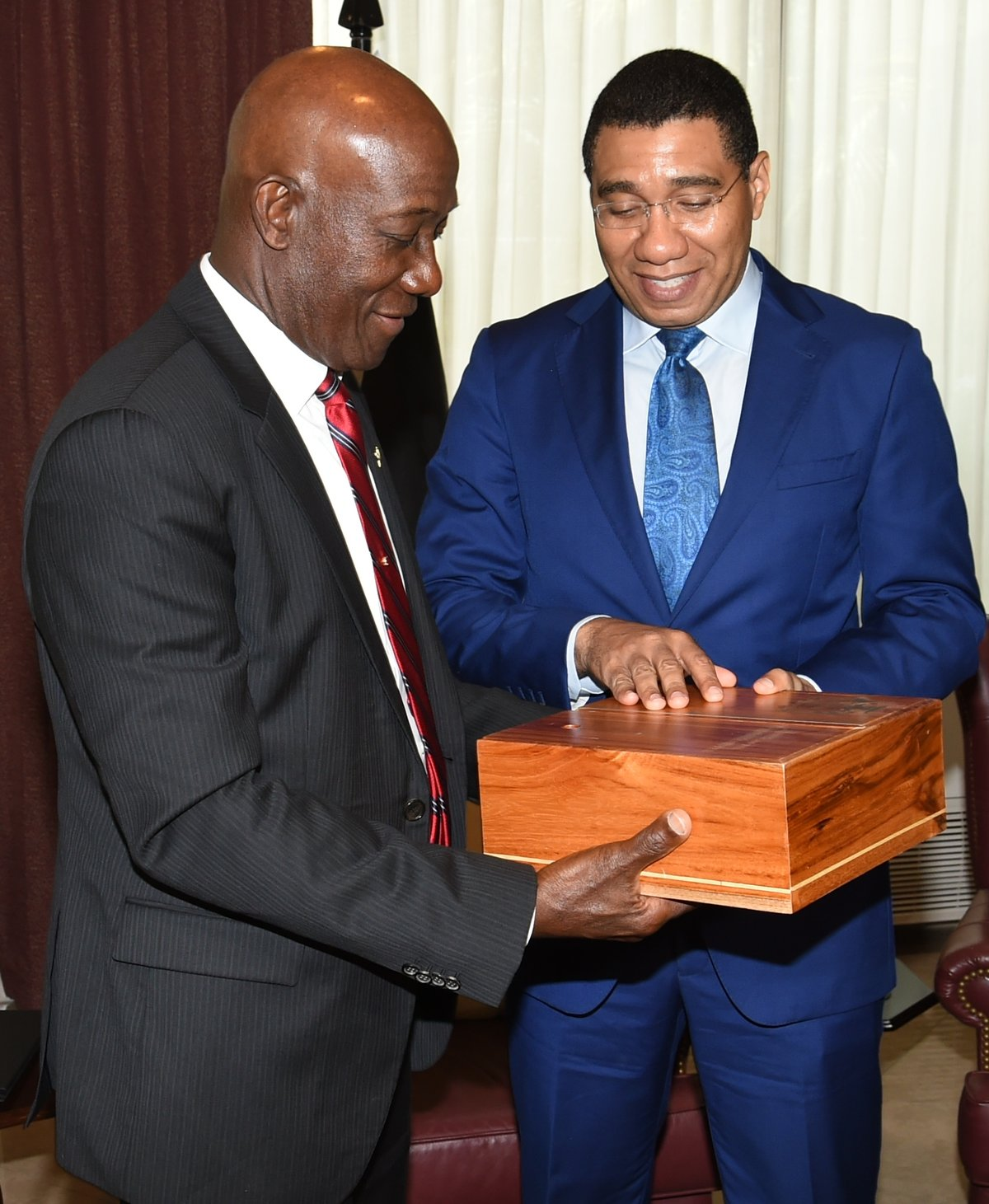 Prime Minister Dr.Keith Rowley,  and Prime Minister of Jamaica the Most Honourable Andrew Holness exchange gifts