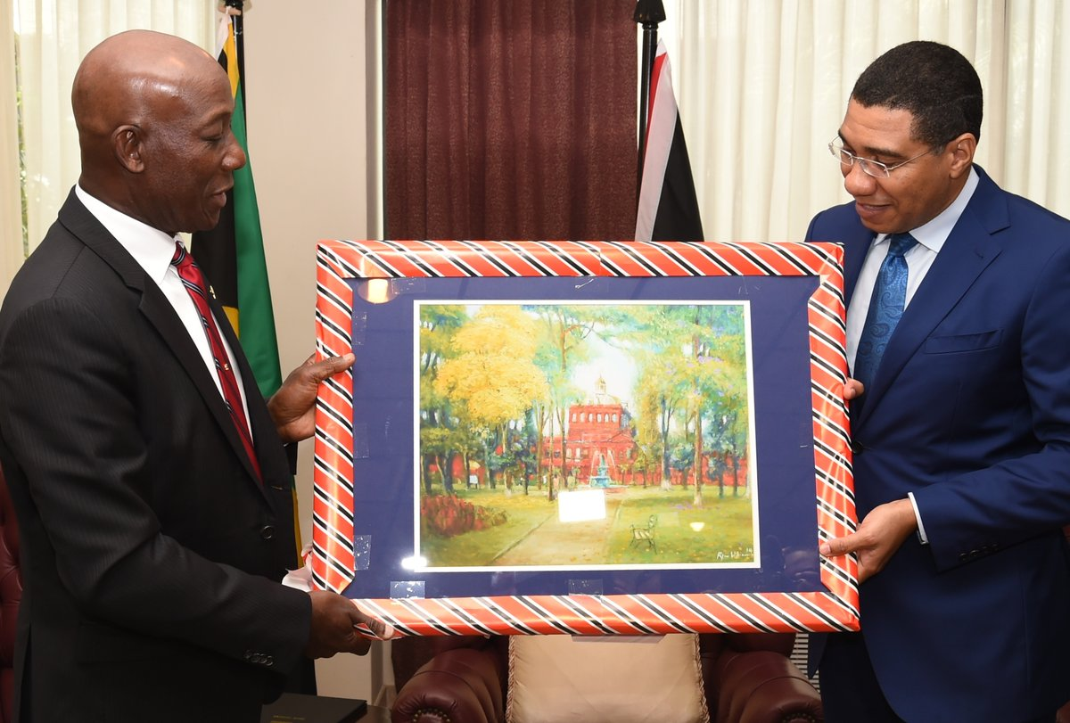 Prime Minister of the Republic of Trinidad and Tobago, Dr.Keith Rowley,  and Prime Minister of Jamaica the Most Honourable Andrew Holness exchange gifts