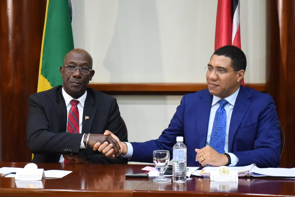 Prime Minister Rowley and Prime Minister Holness shake hands.