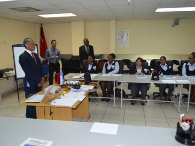 Minister Moses address immigration officers at a Customer Service Training Workshop