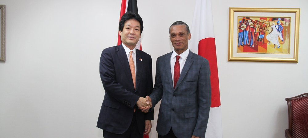 Senator the Honourable Dennis Moses, Minister of Foreign and CARICOM Affairs greets H.E. Kentaro Sonoura, State Minister for Foreign Affairs of Japan during a Courtesy Call on 24th July, 2017.