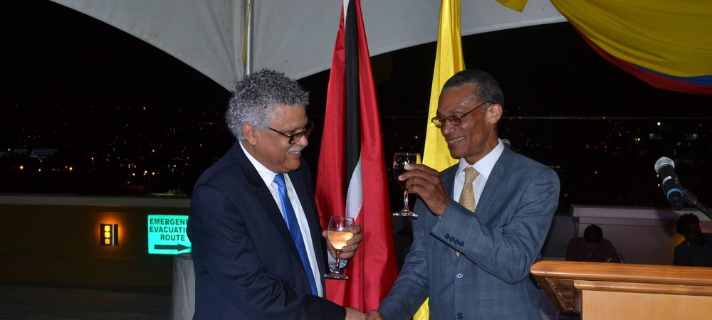 Senator the Honourable Dennis Moses, Minister of Foreign and CARICOM Affairs and H.E. Alfonso Múnera Cavadía, Ambassador  of the Republic of Colombia toast at the reception to commemorate the 207th Anniversary of Independence of the Republic of Colombia