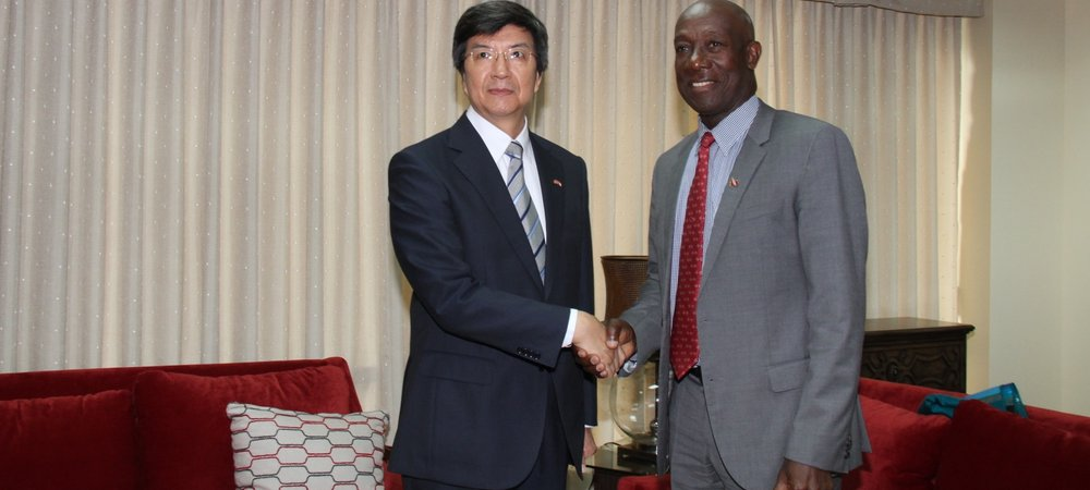 Prime Minister, Dr. the Honourable Keith Rowley greets Song Yumin, Ambassador Extraordinary and Plenipotentiary of the People's Republic of China to the Republic of Trinidad and Tobago