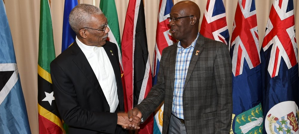 Dr. the Honourable Keith Rowley, Prime Minister of the Republic of Trinidad and Tobago greets His Excellency Brigadier (Ret'd) David A. Granger, President of Guyana at the 28th Inter-Sessional Meeting of the Conference