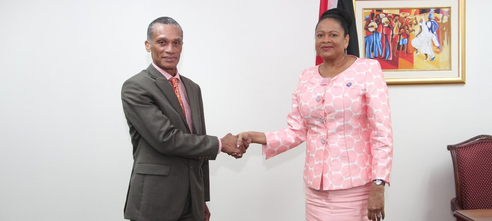 Senator the Honourable Dennis Moses, Minister of Foreign and CARICOM Affairs greets H.E. Dr. June Somer, Secretary General of the Association of Caribbean States during a recent Courtesy Call.