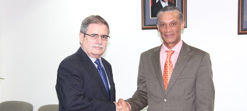 Senator the Honourable Dennis Moses, Minister of Foreign and CARICOM Affairs greets H.E. Guillermo Moreno, Ambassador of Cuba during  a recent meeting at the Ministry's headquarters.