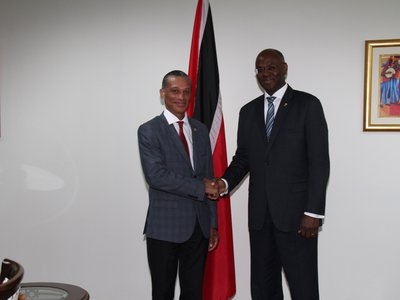 Senator the Honourable Dennis Moses, Minister of Foreign and CARICOM Affairs greets H.E. Eugene B. Holiday, Governor-Head of State of St. Maarten during a Courtesy Call on 2nd June, 2017