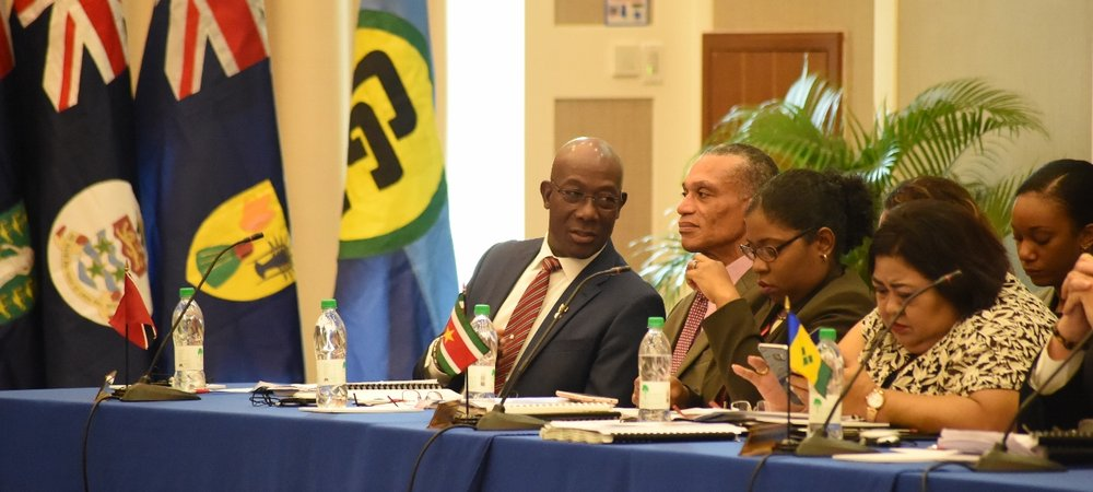 Prime Minister speaks with Honourable Denis Moses at the Opening Session of the 28th Inter-Sessional Meeting
